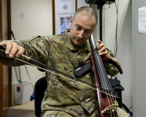 U.S. Air Force Capt. Justin Lewis, Officer in Charge and cellist assigned to the Air Force Central Command Band, practices cello in preparation for a concert at Al Udeid, Air Force Base, Qatar, May 25, 2017. The AFCENT Band, stationed at Al Udeid, travels throughout the Central Command Area of Responsibility in support of building partnerships, boosting morale, and providing diplomacy and outreach to host nation communities. (U.S. Air Force photo by Tech. Sgt. Bradly A. Schneider/Released)