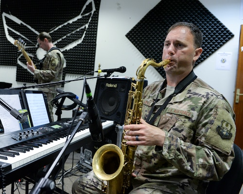 U.S. Air Force Tech. Sgt. Ryan Janus, keyboard player and saxophonist assigned to the Air Force Central Command Band, practices saxophone in preparation for a concert at Al Udeid, Air Force Base, Qatar, May 25, 2017. The AFCENT Band, stationed at Al Udeid, travels throughout the Central Command Area of Responsibility in support of building partnerships, boosting morale, and providing diplomacy and outreach to host nation communities. (U.S. Air Force photo by Tech. Sgt. Bradly A. Schneider/Released)