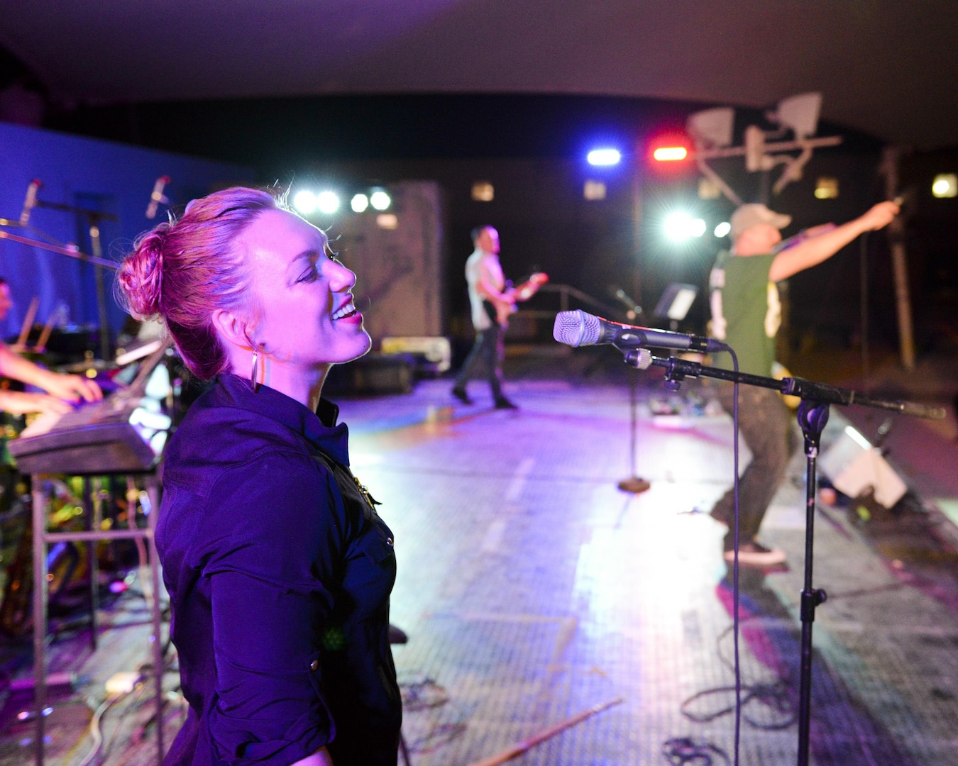 U.S. Air Force Airman 1st Class Anneke Bentley, left foreground, and Staff Sgt. Denver Murphy, vocalists assigned to the Air Force Central Command Band, sing during a concert at Al Udeid, Air Force Base, Qatar, May 26, 2017. The AFCENT Band, stationed at Al Udeid, travels throughout the Central Command Area of Responsibility in support of building partnerships, boosting morale, and providing diplomacy and outreach to host nation communities. (U.S. Air Force photo by Tech. Sgt. Bradly A. Schneider/Released)