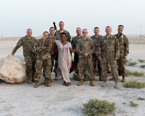 Members of the Air Forces Central Command Band pose for a photograph with Melinda Doolittle, an accomplished vocalist and top finisher on American Idol, following a practice session held at an outside venue in preparation for a concert at Al Udeid Air Base, Qatar, May 25, 2017. The AFCENT Band, stationed at Al Udeid, travels throughout the Central Command Area of Responsibility in support of building partnerships, boosting morale, and providing diplomacy and outreach to host nation communities. (U.S. Air Force photo by Tech. Sgt. Bradly A. Schneider/Released)