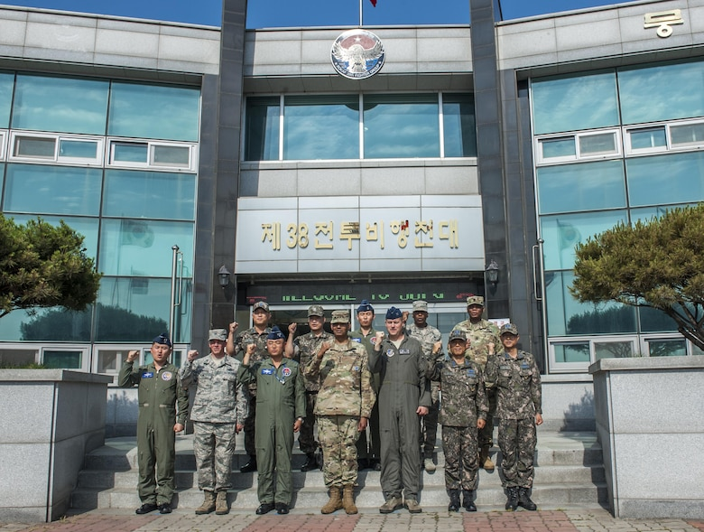 U.S. Army Gen. Vincent K. Brooks, United States Forces Korea commander, center, poses for a photo outside of the 38th Fighter Group Headquarters with members of the Wolf Pack and Republic of Korea Air Force at Kunsan Air Base, Republic of Korea, June 22, 2017. Brooks visited Kunsan Air Base to meet different squadrons which contribute to the mission capable forces he commands and familiarize himself with the base and its capabilities. (U.S. Air Force photo by Senior Airman Colville McFee/Released)