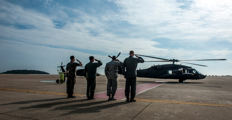 U.S. Air Force and Republic of Korea Air Force service leadership at Kunsan Air Base, Republic of Korea, render a salute as U.S. Army Gen. Vincent K. Brooks's U.S. Army UH-60 prepares to depart the base June 22, 2017.  During his visit, Brooks toured multiple squadrons around the installation to familiarize himself with the capabilities which support the overall USFK mission and to recognize and talk with outstanding performers throughout the base. (U.S. Air Force photo by Senior Airman Colville McFee/Released)