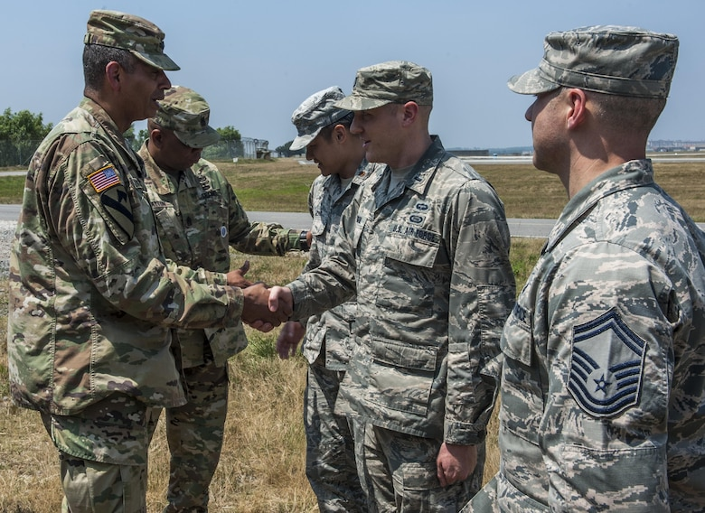 U.S. Army Gen. Vincent K. Brooks, United States Forces Korea commander, coins an Airman assigned to the 8th Operations Group, recognizing him as an outstanding performer at Kunsan Air Base, Republic of Korea, June 22, 2017. During his visit, Brooks recognized Airmen from multiple units for their hard work. (U.S. Air Force photo by Senior Airman Colville McFee/Released)