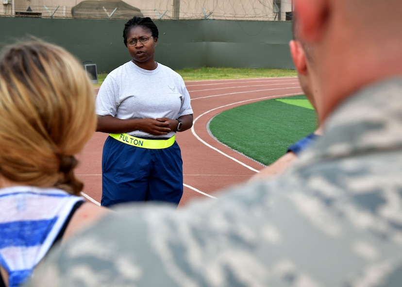 "U.S. Air Force Lt. Col. Breanna Fulton, 731st Air Mobility Squadron commander, speaks about U.S. Air Force Staff Sgt. Cierra Rogers prior to a fitness challenge June 23, 2017 at Osan Air Base, Republic of Korea. The 731st AMS along with the Osan Top Three Heritage Committee and the 51st Force Support Squadron Fitness Staff unveiled a memorial and hosted the ""Rogers Fit Workout"" challenge in honor of Rogers, who has passed away May 20, 2016, due to injuries she sustained from helping a family escape a burning apartment building. (U.S. Air Force photo by Senior Airman Franklin R. Ramos/Released)"