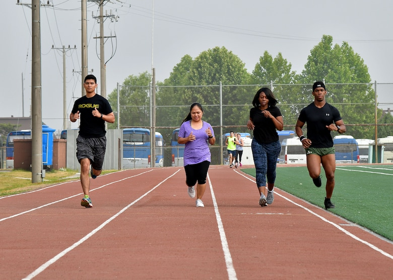 "Members of Osan Air Base run on the track during the ""Rogers Fit Workout"" challenge June 23, 2017 at Osan AB, Republic of Korea. The 731st AMS along with the Osan Top Three Heritage Committee and the 51st Force Support Squadron Fitness Staff unveiled a memorial and hosted the ""Rogers Fit Workout"" challenge in honor of Rogers, who has passed away May 20, 2016, due to injuries she sustained from helping a family escape a burning apartment building. (U.S. Air Force photo by Senior Airman Franklin R. Ramos/Released)"