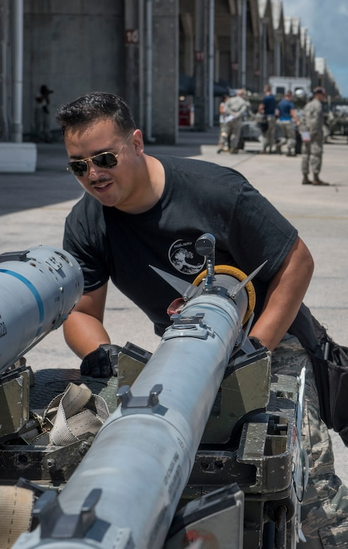 U.S. Air Force Senior Airman Israel Vasquez, 120th Fighter Squadron weapons load team crew member, inspects an AIM-9 sidewinder missile during a quarterly weapons load competition June 23, 2017, at Kadena Air Base, Japan. The Colorado Air National Guard Fighter Squadron, from Buckley Air Force Base, Colo., is touring Kadena as part of a theater security package. (U.S. Air Force photo by Senior Airman John Linzmeier)