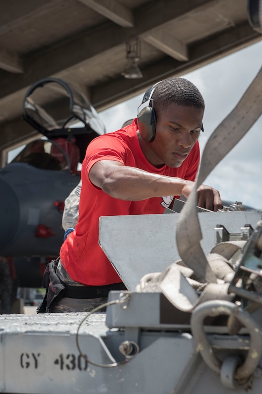 U.S. Air Force Senior Airman Deshawn Jemison, 67th Aircraft Maintenance Unit weapons load team crew member, inspects an AIM-9 sidewinder missile during a quarterly weapons load competition June 23, 2017, at Kadena Air Base, Japan. The competition was held between the 44th and 67th Aircraft Maintenance Units and the 120th Fighter Squadron, from Colorado Air National Guard, Buckley Air Force Base, for quickest and most accurate loading of weapons on their respective aircraft. (U.S. Air Force photo by Senior Airman John Linzmeier)