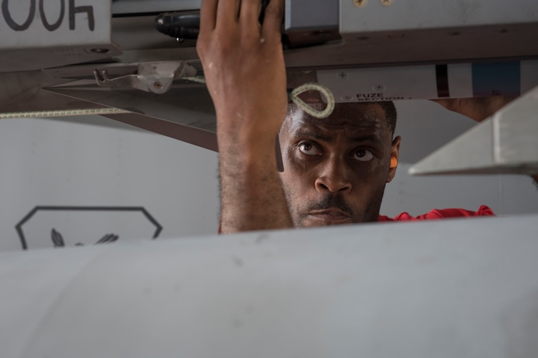 U.S. Air Force Staff Sgt. Jason Jones, 67th Aircraft Maintenance Unit weapons load team lead crew chief, inspects an F-15 Eagle during a quarterly weapons load competition June 23, 2017, at Kadena Air Base, Japan. The competition evaluated safety, reliability and effectiveness while adhering to technical data and explosive safety. (U.S. Air Force photo by Senior Airman John Linzmeier)