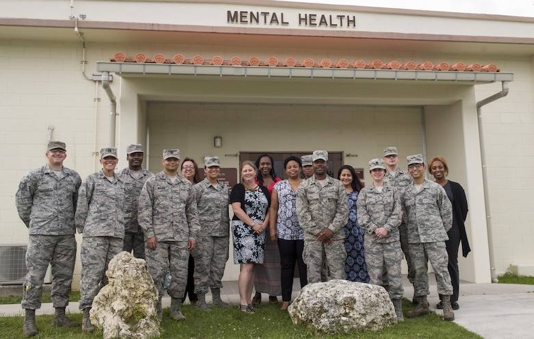 Mental health providers from the 18th Medical Operations Squadron stand for a group photo in front of the Kadena Mental Health Clinic June 26, 2017, at Kadena Air Base, Japan. The Kadena Mental Health Clinic serves the mental health needs of more than 16,000 joint service beneficiaries, including U.S. military service members, veterans, and their families. (U.S. Air Force photo by Senior Airman Omari Bernard)