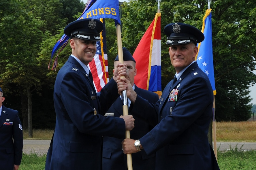 U.S. Air Force Col. Richard K. Bohn Jr., 52nd Munitions Maintenance Group commander, gives the ceremonial guidon to U.S. Air Force Lt. Col. Christopher Graves, 703rd Munitions Support Squadron commander, during the 703rd MUNSS change of command ceremony on Royal Netherlands Air Force, Vokel, the Netherlands, June 23, 2017. (U.S. Air Force photo by Master Sgt. Jonathan Mercado)
