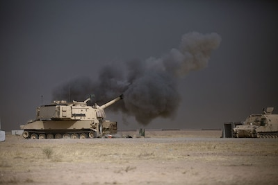 Army M109A6 Paladin conducts fire mission at Qayyarah West, Iraq, in support of Iraqi security forces' push toward Mosul, October 17, 2016, to defeat so-called Islamic State (U.S. Army/Christopher Brecht)