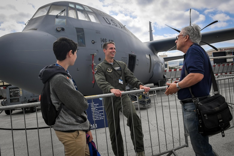 A C-130J Super Hercules loadmaster from Channel Islands, California, speaks to air show attendees at Le Bourget Airport, France, during the Paris Air Show, June 23, 2017. The Paris Air Show offers the U.S. a unique opportunity to showcase their leadership in aerospace technology to an international audience. By participating, the U.S. hopes to promote standardization and interoperability of equipment with their NATO allies and international partners. This year marks the 52nd Paris Air Show and the event features more than 100 aircraft from around the world. (U.S. Air Force photo/ Tech. Sgt. Ryan Crane)
