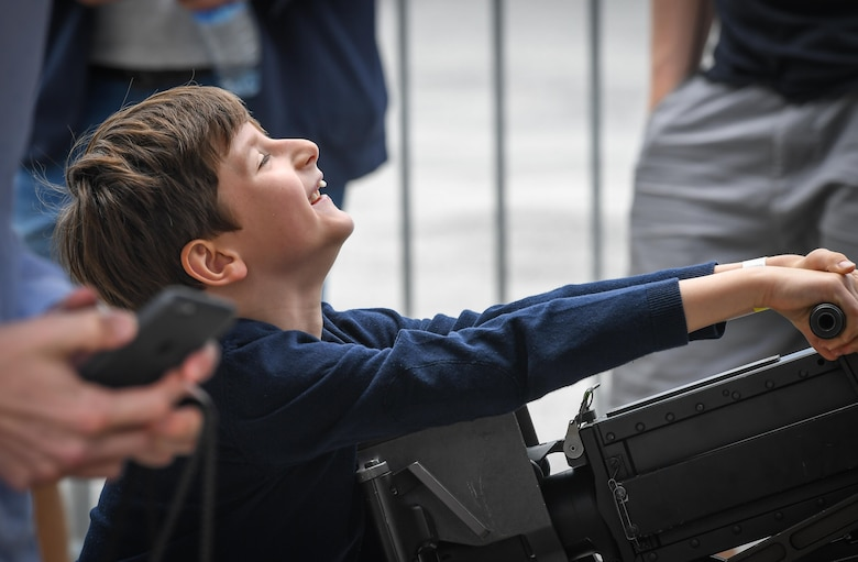 A child struggles to rack a machine gun attached to a CV-22 Osprey from Royal Air Force Mildenhall, England, at Le Bourget Airport, France, during the Paris Air Show, June 23, 2017. The Paris Air Show offers the U.S. a unique opportunity to showcase their leadership in aerospace technology to an international audience. By participating, the U.S. hopes to promote standardization and interoperability of equipment with their NATO allies and international partners. This year marks the 52nd Paris Air Show and the event features more than 100 aircraft from around the world. (U.S. Air Force photo/ Tech. Sgt. Ryan Crane)