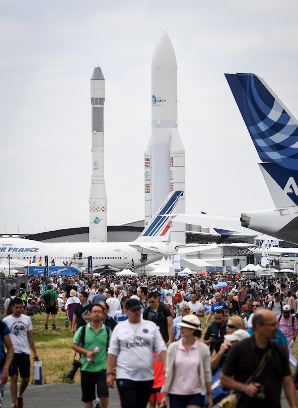 Crowds make their way to the aerial demonstration viewing area at Le Bourget Airport, France, during the Paris Air Show, June 23, 2017. The Paris Air Show offers the U.S. a unique opportunity to showcase their leadership in aerospace technology to an international audience. By participating, the U.S. hopes to promote standardization and interoperability of equipment with their NATO allies and international partners. This year marks the 52nd Paris Air Show and the event features more than 100 aircraft from around the world. (U.S. Air Force photo/ Tech. Sgt. Ryan Crane)