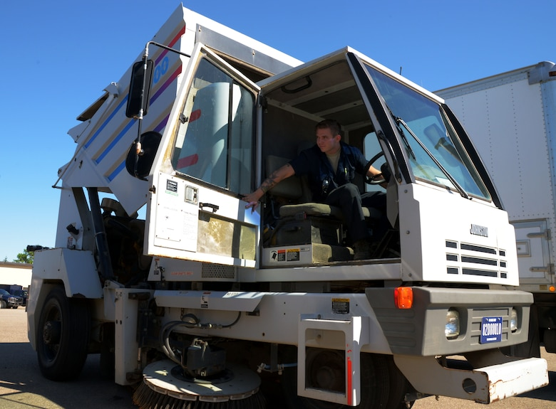 Senior Airman Dalton Dritz, 5th Logistics Readiness Squadron vehicle maintainer, lifts a street sweeper bed at Minot Air Force Base, N.D., June 19, 2017. The 5th LRS vehicle maintainers determine serviceability, overall condition of the vehicles, and need for repair through visual and audio examinations. (U.S. Air Force photo by Airman 1st Class Dillon J. Audit)