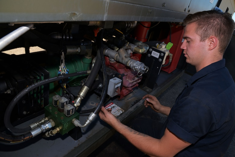 Senior Airman Dalton Dritz, 5th Logistics Readiness Squadron vehicle maintainer, inspects the de-icing and anti-icing pumps on a de-icer at Minot Air Force Base, N.D., June 19, 2017. Vehicle maintenance is performed on various military, commercial and special purpose vehicles, as well as other vehicular equipment. (U.S. Air Force photo by Airman 1st Class Dillon J. Audit)