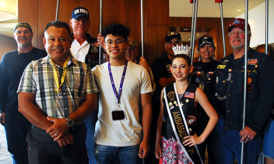 Master Sgt. Juan Guerra (front, left) and his son, Joel (front, right), pose for a photo opportunity with the San Antonio Patriot Guard Riders, a local group that supports veterans, at the end of the Air Force Reserve Yellow Ribbon Reintegration Program event held June 16-18, 2017, in San Antonio, Texas. This trip was special for the father-son duo because Joel is considering joining the Air Force after high school, and may return here at some point for basic military training. (U.S. Air Force photo by Master Sgt. Leisa Grant)