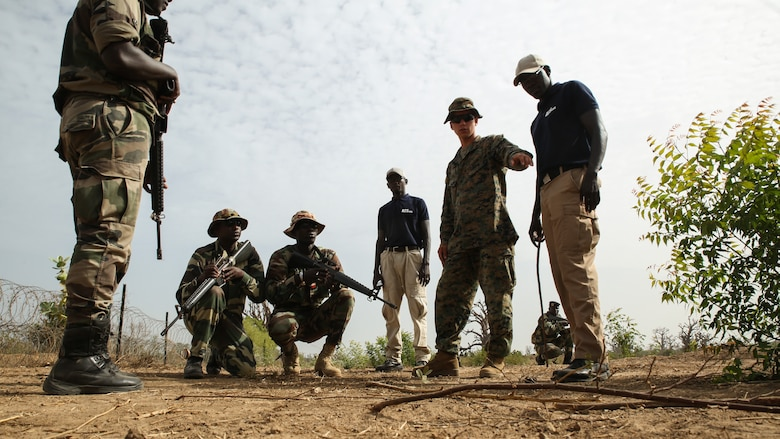 Lance Cpl. Mason Shaw, a combat engineer with Special Purpose Marine Air-Ground Task Force – Crisis Response – Africa, points out an anomaly in the baseline to soldiers with Senegal's 5th Contingent in Mali during a peacekeeping operations training mission at Thies, Senegal, June 7, 2017. Marines and Sailors with SPMAGTF-CR-AF served as instructors and designed the training to enhance the commandos' abilities to successfully deploy in support of United Nations peacekeeping missions in the continent. (U.S. Marine Corps photo by Sgt. Samuel Guerra/Released)
