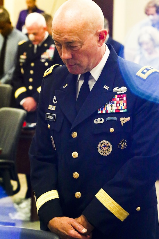 Lt. Gen. Charles D. Luckey, Chief of Army Reserve and Commanding General, United States Army Reserve, prays during Maj. Gen. David Conboy's retirement ceremony at Fort Bragg, NC, June 23, 2017. The  CG stated that Conboy was instrumental in providing him with a candid and complete view of where the Army Reserve currently is and where it needs to go. (U.S. Army photo by Staff Sgt. Felix R. Fimbres)
