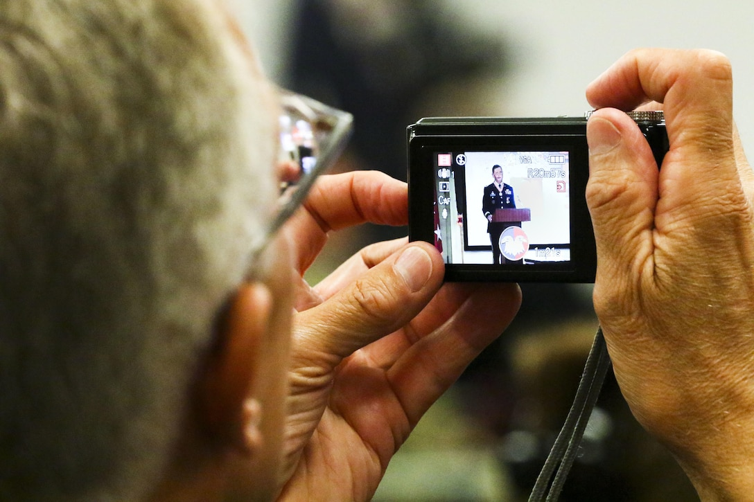 An audience member takes a photo of Maj. Gen. David Conboy during his retirement ceremony at Fort Bragg, NC, June 23, 2017. The ceremony honored Conboy for his impact on not only the Army Reserve, but the nation and its allies as well over a 33-year career. (U.S. Army photo by Staff Sgt. Felix R. Fimbres)