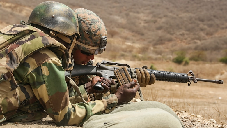 Cpl. Hayden Garrett, a rifleman with Special Purpose Marine Air-Ground Task Force – Crisis Response – Africa, coaches a soldier with Senegal's 5th Contingent in Mali through remedial action of the M16A2 rifle during a peacekeeping operations training mission at Thies, Senegal, June 9, 2017. Marines and Sailors with SPMAGTF-CR-AF served as instructors and designed the training to enhance the commandos' abilities to successfully deploy in support of United Nations peacekeeping missions in the continent. (U.S. Marine Corps photo by Sgt. Samuel Guerra/Released)
