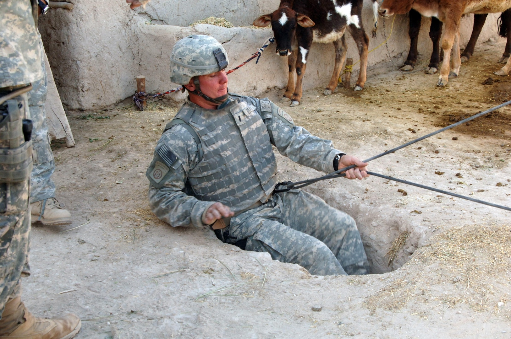 1st Lt. Scott Dewitt, of Company B, 2nd Battalion, 508th Parachute Infantry Regiment, rappels underground to search for weapons caches in the village of Bagi Khel, Afghanistan. (Photo Credit: Staff Sgt. Marcus J. Quarterman)