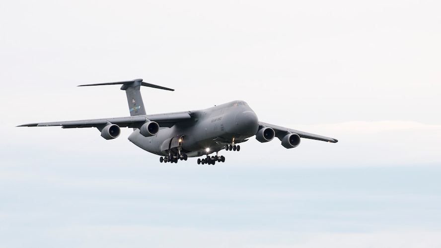 A C-5M Super Galaxy, operated by the C-5M Formal Training Unit, approaches runway 01-19 for landing June 8, 2017, at Dover Air Force Base, Del. The C-5M is the largest transport aircraft operated by the U.S. Air Force and provides heavy intercontinental-range strategic airlift capabilities. (U.S. Air Force photo by Senior Airman Zachary Cacicia)