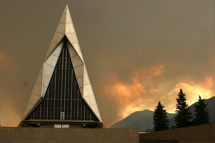 The U.S. Air Force Academy is shrouded in smoke from the flames of the nearby Waldo Canyon fire July 26, 2017. The fire began June 23, 2017 in Waldo Canyon, a popular hiking area near the school. (U.S. Air Force Academy photo)