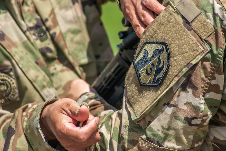 Members of the 2nd Battalion, 48th Infantry Regiment color guard receive their 3rd Chemical Brigade patches during the battalion activation ceremony Friday.   (Photo Credit: Mr. Stephen Standifird (Leonard Wood)