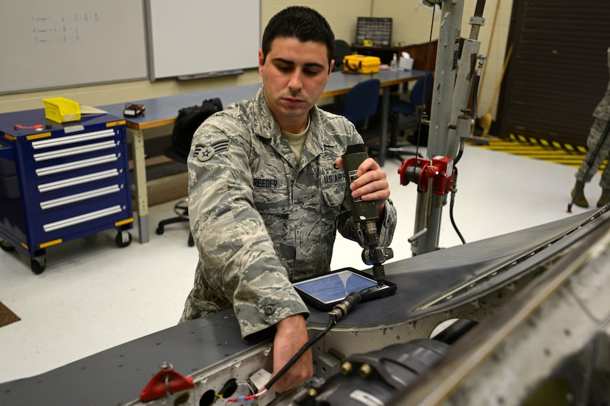 U.S. Air Force Senior Airman Collin Reeder, weapons standardization technician assigned to the 96th Maintenance Group at Eglin Air Force Base, Fla., assists in a gun hydraulic bleed and leak test on a mock F-16CM Fighting Falcon body during training at the 372nd Training Squadron, Detachment 202 F-16 Field Training Detachment (FTD) at Shaw Air Force Base, S.C., April 25, 2017.  Reeder spent approximately three weeks at Shaw to attend the advanced aircraft equipment and munitions training offered by the FTD. (U.S. Air Force photo by Senior Airman Kelsey Tucker)