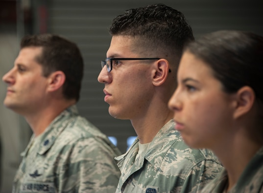 Senior Airman Kyle Belmares (center), 96th Communications Squadron cable and antenna systems, stands alongside Airman 1st Class Jaylyn Smith (right) and his squadron commander, Lt. Col. Matthew Imperial, during an awards ceremony June 20 on Eglin Air Force Base, Fla. Belmares and Smith were awarded Air Force Commendation Medals for life-saving care in response to a severe vehicle accident in February. (U.S. Air Force photo/Jasmine Porterfield)