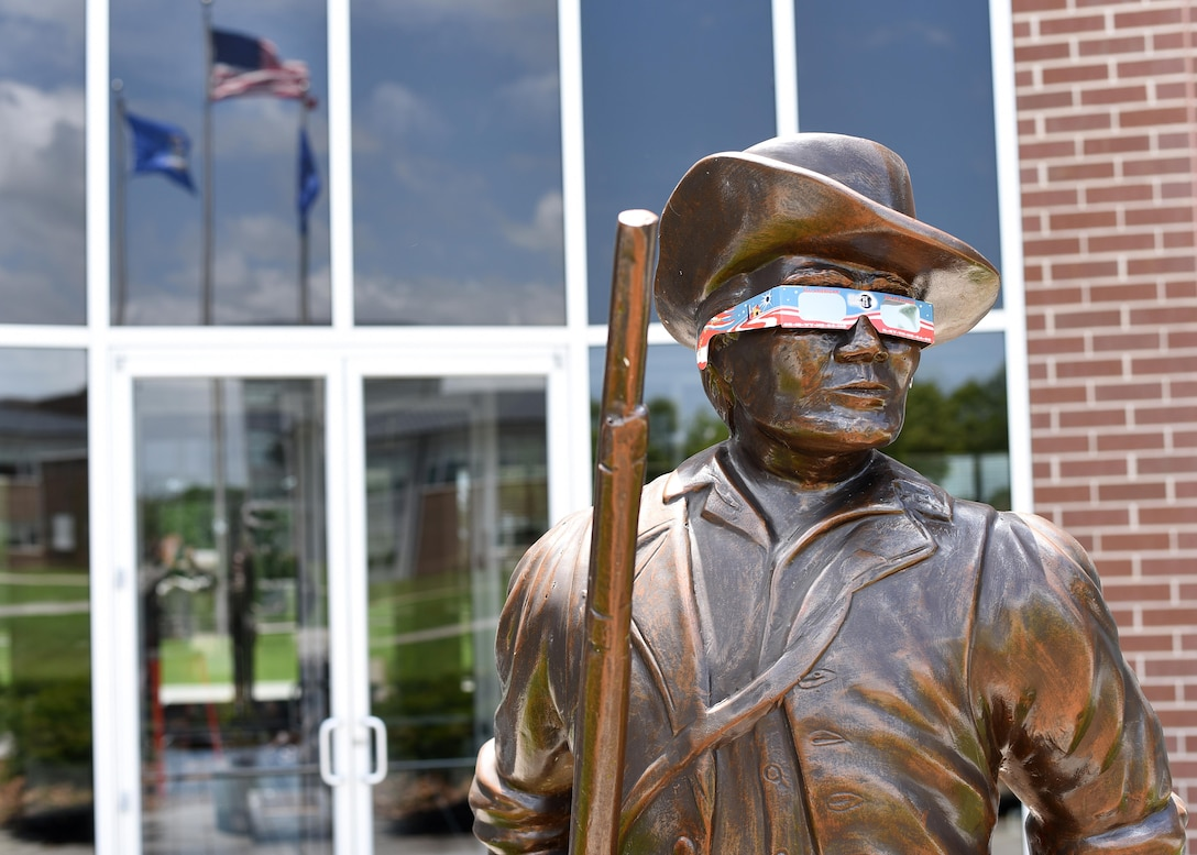 The Minuteman statue outside Patriot Hall at the Air National Guard's I.G. Brown Training and Education Center dons a pair of eclipse glasses, June 22, 2017, to emphasize the need for safe viewing of the coming solar eclipse. The training center as well as the rest of McGhee Tyson Air National Guard Base in Louisville, Tenn., is within the path of totality during the event, Monday, August 21, 2017. (U.S. Air National Guard photo by Master Sgt. Mike R. Smith)