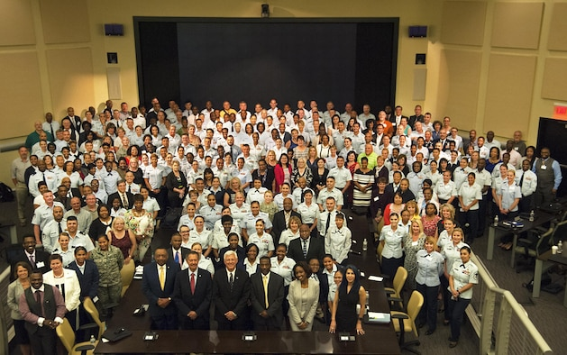 Attendees and presenters pose for a photo at the 2017 Equal Opportunity Worldwide Training Workshop on Joint Base Andrews, Md., June 12, 2017. Approximately 300 equal opportunity professionals from the Air Force Reserve, Air National Guard, Air Force active duty and U.S. government attended the week-long workshop that provided required refresher skills training. (U.S. Air Force photo by Christopher Hurd)