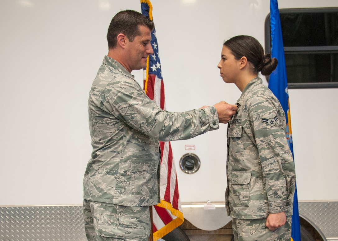 Lt. Col. Matthew Imperial (right), 96th Communication Squadron commander, presents Airman 1st Class Jaylyn Smith, 96th CS cable and antenna systems, with an Air Force Commendation Medal at an awards ceremony June 20 on Eglin Air Force Base, Fla. Smith was one of two Airmen recognized for life-saving care in response to a severe vehicle accident in February. (U.S. Air Force photo/Jasmine Porterfield)