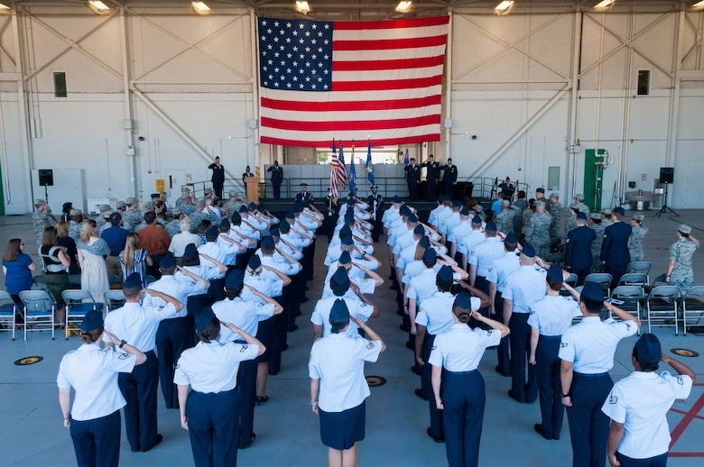 Staff Sgt. Tinese Jackson, 9th Intelligence Squadron optical bar camera mission manager, sings the national anthem during the presentation of the colors during a change of command ceremony at Beale Air Force Base, Calif., June 14, 2017. The change of command ceremony represents the formal passing of responsibility, authority and accountability of command from one officer to another. (U.S. Air Force photo by Senior Airman Lauren Parsons/Released)