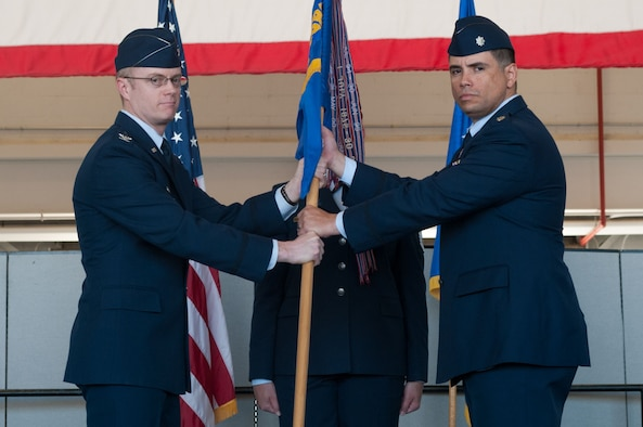 Col. Jacob J. Holmgren,  548th Intelligence, Surveillance and Reconnaissance Group commander, passes the guidon to Lt. Col. Luis J. Adames, 9th Intelligence Squadron incoming commander, during the 9th IS change of command ceremony at Beale Air Force Base, Calif., June 14, 2017. The 9th IS conducts 24/7, real-time intelligence, surveillance and reconnaissance operations as a part of Distributed Ground Site-2 in direct support of combat operations, national, Department of Defense and Air Force leaders, key coalition partners and combatant commanders worldwide. (U.S. Air Force photo by Senior Airman Lauren Parsons/Released)