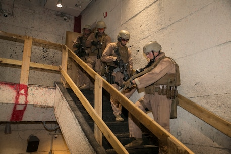 Staff Sgt. Joseph Pistone, chief instructor, Close Quarters Battle course, Training Co., Marine Corps Security Force Regiment, acts as point man as the Marines move from floor to floor clearing the building during instructor progression training at Naval Support Activity Northwest Annex, Chesapeake, Va., June 23. The instructors completed the tactical training as part of their quarterly requirements which also includes rifle and pistol range qualifications. (Official U.S. Marine Corps photo by Cpl. Logan Snyder/ Released)