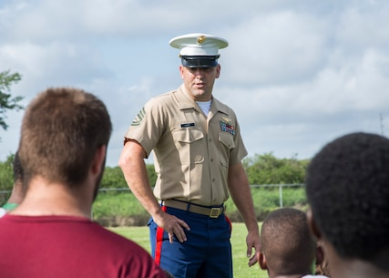 Gunnery Sergeant Jason Hart, a recruiter with Recruiting Substation (RSS) Winter Haven, speaks to football players at Haines City High School in Haines City, Florida, June 22, 2017. The Marines with RSS Winter Haven taught football players the importance of teamwork.  (U.S. Marine Corps photo by Lance Cpl. Jack A. E. Rigsby)