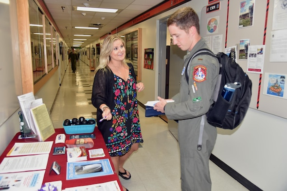 Saralauren Peacock, 82nd Medical Group Registered Dietitian, provides health information to an 80th Flying Training Wing student pilot in spirit of Men's Health Month, June 26, 2017. An estimated 80 percent of chronic diseases can be prevented or managed with healthy lifestyle choices. (U.S. Air Force photo by 2nd Lt. Jacqueline Jastrzebski)