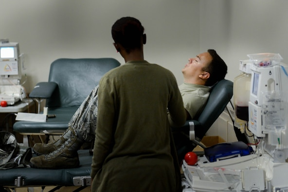 A LifeShare technician assists a donor as he gives blood during the 2017 LifeShare Blood Drive at Barksdale Air Force Base, La., June 16, 2017. Approximately 32,000 pints of blood are used each day in the United States. (U.S. Air Force Photo/Airman 1st Class Sydney Bennett)