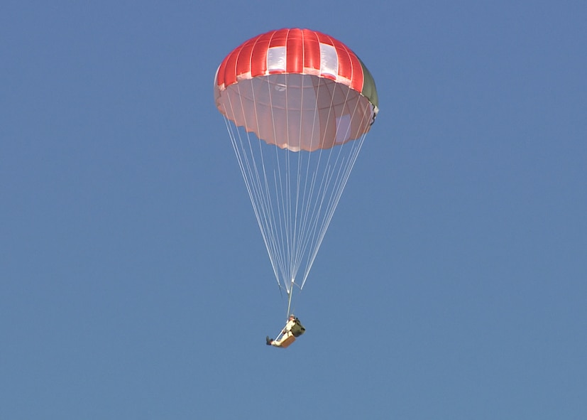 A GR7000 parachute along with dummy descends over a drop zone near Edwards Air Force Base. A team from the 418th Flight Test Squadron conducted several drops using the parachute, which has been proposed as a replacement for the current C-9 canopy used in the ACES II ejection seat. (U.S. Air Force image provided by Brad White)