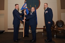 Lt. Col. Danielle R. Kirk, 460th Logistics Readiness Squadron incoming commander, receives the guidon, symbolizing the official change of command June 23, 2017, on Buckley Air Force Base, Colo.  Kirk is now the commander of a squadron that provides logistics support for over 6,000 personnel. (U.S. Air Force photo by Airman 1st Class Holden S. Faul/ released)