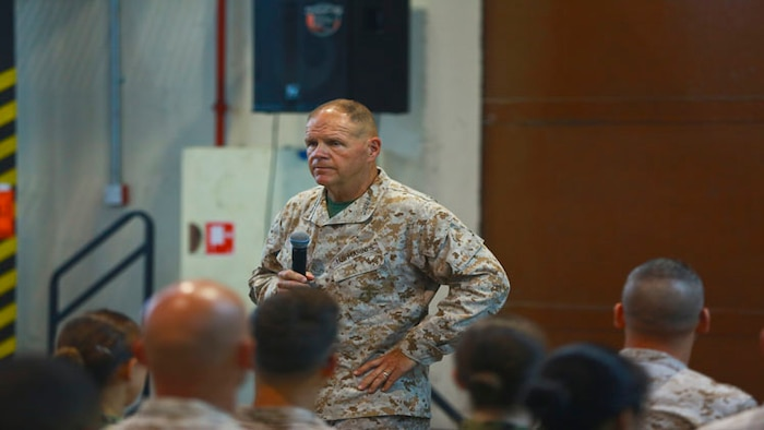 Commandant of the Marine Corps, Gen. Robert B. Neller speaks to the Marines and Sailors with Naval Amphibious Forces, Task Force 51/5th Marine Expeditionary Brigade (TF 51/5) during a town-hall meeting aboard Naval Support Activity Bahrain, June 21. During the town-hall, Neller discussed updated social media guidance, his expectation that Marines will treat each other with dignity and respect, as well as, the importance of naval integration.