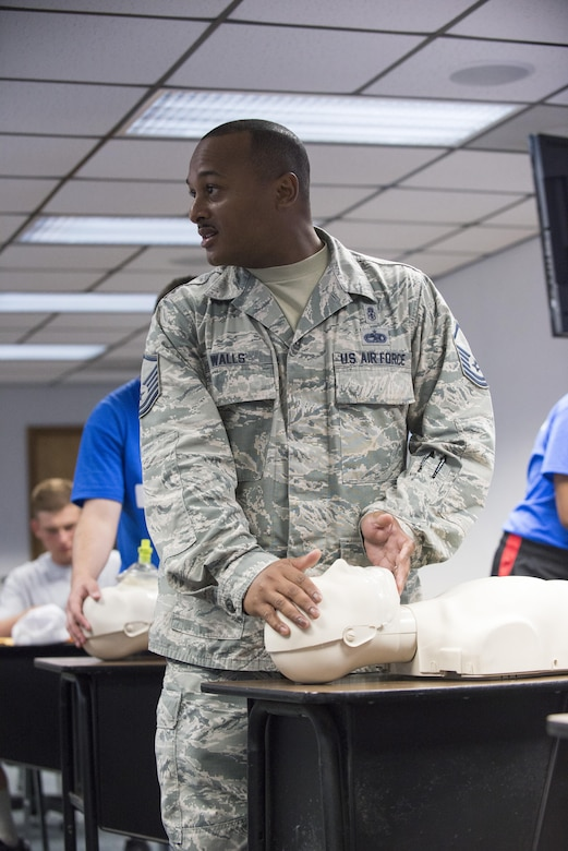 Master Sgt. Jason Walls, 436th Medical Operations Squadron family health flight chief, explains how to open an airway during the Delaware Cadet Leadership Course June 21, 2017, at the Delaware National Guard training site at Bethany Beach, Del. For 20 years, Delaware's Junior ROTC cadets have participated in this event. (U.S. Air Force photo by Staff Sgt. Jared Duhon)
