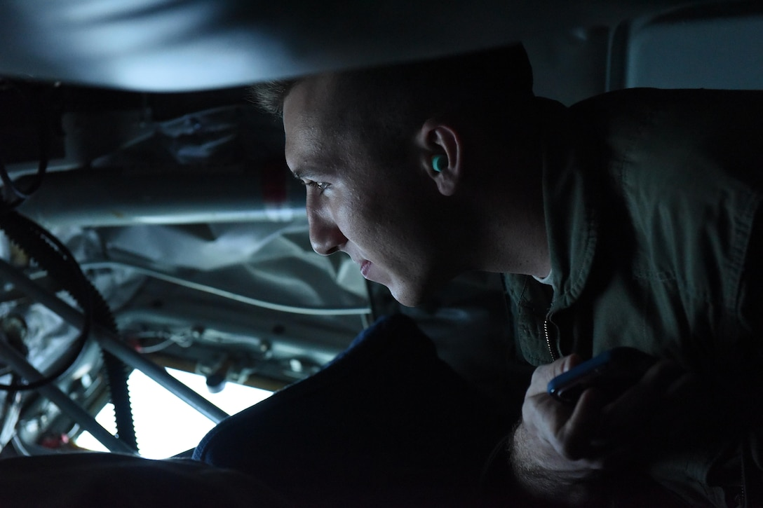 Jesse Haggerty, U.S. Air Force Academy cadet, watches as a 916th Air Refueling Wing boom operator prepares to refuel an aircraft during Exercise Razor Talon, June 8, 2017, in the skies above Seymour Johnson Air Force Base, North Carolina. Ten cadets from the Academy experienced the different career fields in the Air Force such as security forces, maintenance, operations and force support, during Operation Air Force. (U.S. Air Force photo by Airman 1st Class Miranda A. Loera)