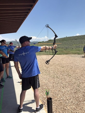 Following lunch with Utah Army and Air National Guardsmen, Air Force Vice Chief of Staff Gen. Stephen W. Wilson tested out the adaptive archery equipment at the National Ability Center in Park City, Utah on June 21, 2017. The National Ability Center, a nonprofit organization that provides adaptive recreation opportunities for individuals of all abilities through sports, activities and education,  was one stop on Wilson's multi-day visit to the state. (U.S. Air National Guard photo by Maj. Jennifer Eaton)