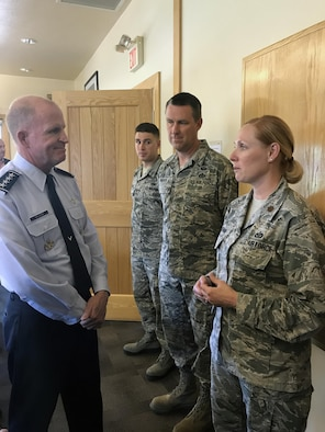 Air Force Vice Chief of Staff Gen. Stephen W. Wilson chats with Maj. Sasha Perronne, 151st Civil Engineering Squadron, before lunch at the National Ability Center in Park City, Utah on June 21, 2017. Wilson dined with 20 Army and Air National Guardsmen, answered questions about current Air Force issues, and discussed Chief of Staff of the Air Force Gen. David L. Goldfein's leadership vision.