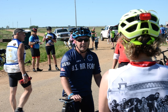 Maj. Anthony Bares, the director of wing inspections assigned to the 28th Bomb Wing Inspector General office, speaks with participants of the Ride Across South Dakota off Highway 44, S.D., June 4, 2017. Bares took up cycling in 2004 as a way to train for triathlons, and leads the Dakota Regional Air Force Cycling Team. (U.S. Air Force photo by Airman 1st Class Thomas Karol)