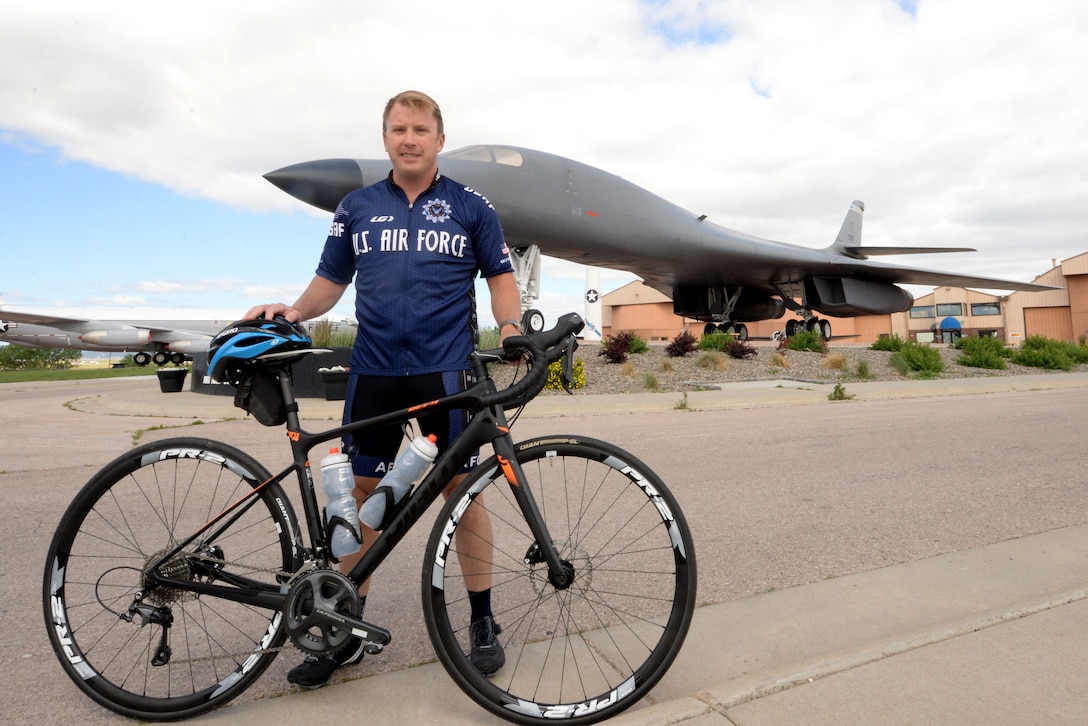 Maj. Anthony Bares, the director of wing inspections assigned to the 28th Bomb Wing Inspector General office, poses with his bike at the South Dakota Air and Space Museum, Box Elder, S.D., June 23, 2017. Bares currently leads the Dakota Regional Air Force Cycling Team, which includes six Airmen assigned to Ellsworth, five Airmen from Minot AFB, N.D., two Air Force reservists and two civilians. (U.S. Air Force photo by Staff Sgt. Hailey Staker)