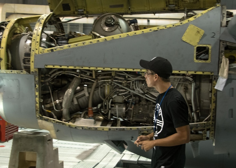 A student from the Aviation Institute of Maintenance school examines the mechanics of a C-130H3 Hercules engine in a hangar at Dobbins Air Reserve Base, Ga. June 23, 2017. Many of the students are working on becoming certified as airframe and powerplant technicians so the tour provided an opportunity to see a possible work environment. (U.S. Air Force photo/Staff Sgt. Andrew Park)